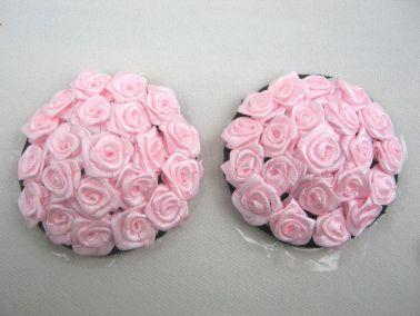Cubrepezones con delicadas rosas de forma redonda
