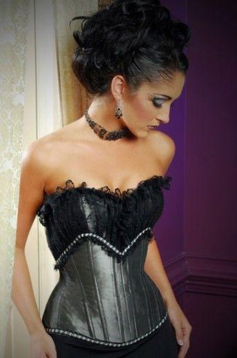 Elegante corset sexy plateado con encaje superpuesto en el pecho y detalles de entredos blanco