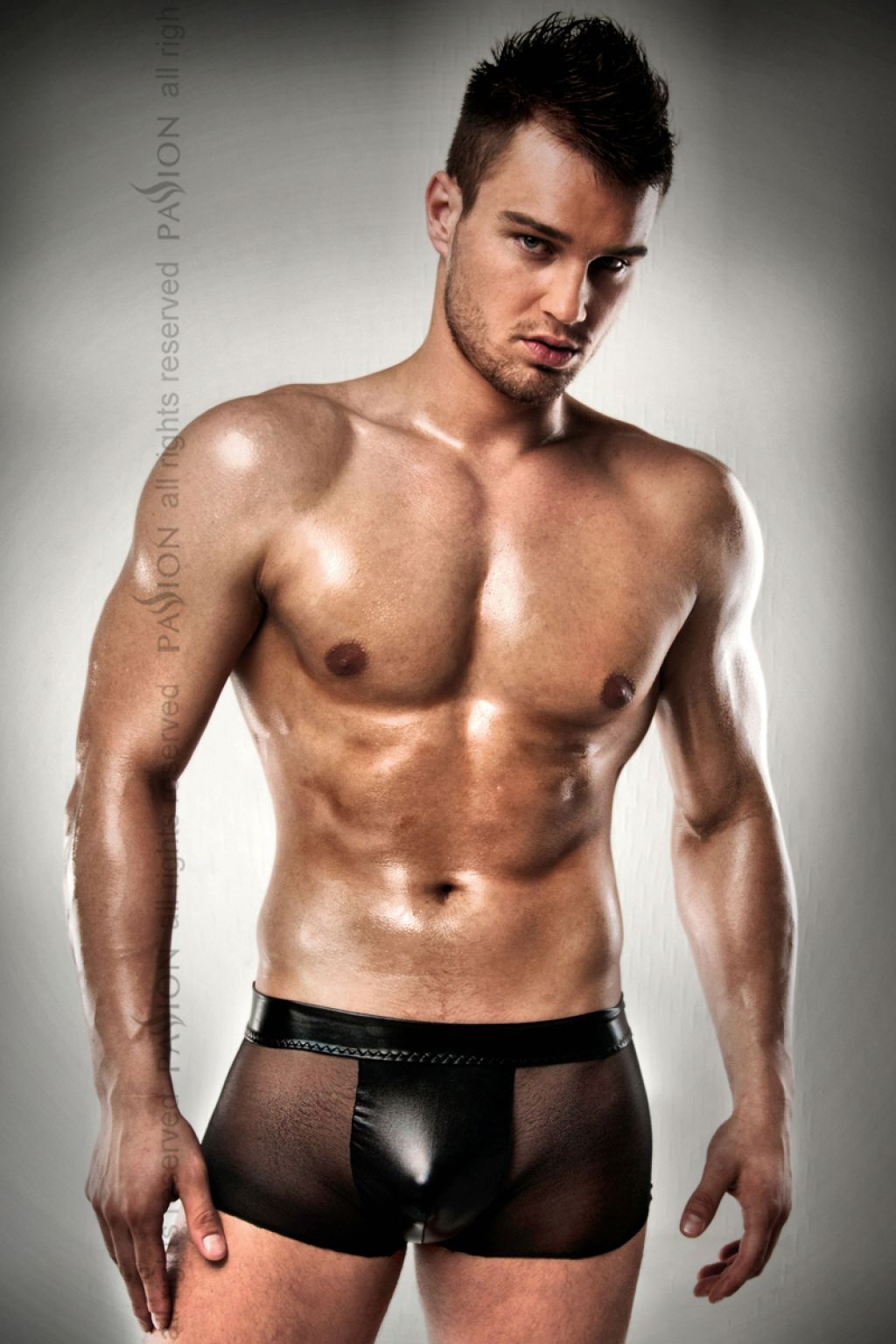 Mini boxer de hombre transparente con suspensorio de latex
